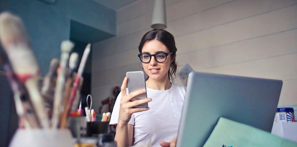 Female designer using phone