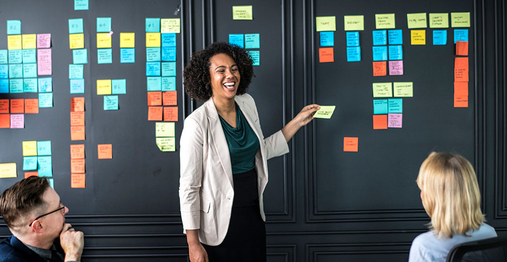 Female business founder using sticky notes