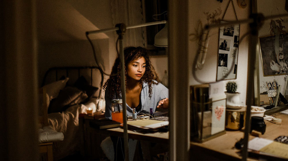 Female entrepreneur working late night at desk