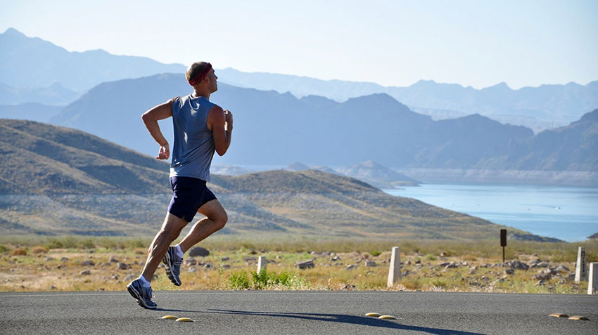Man jogging outside on the road
